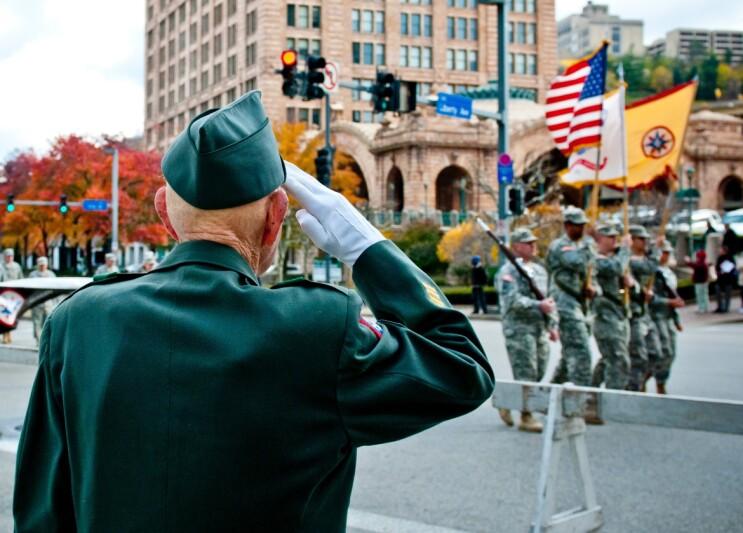 Veteran saluting at a military parade