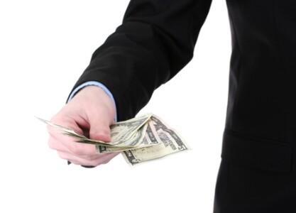 shutterstock_holding_money