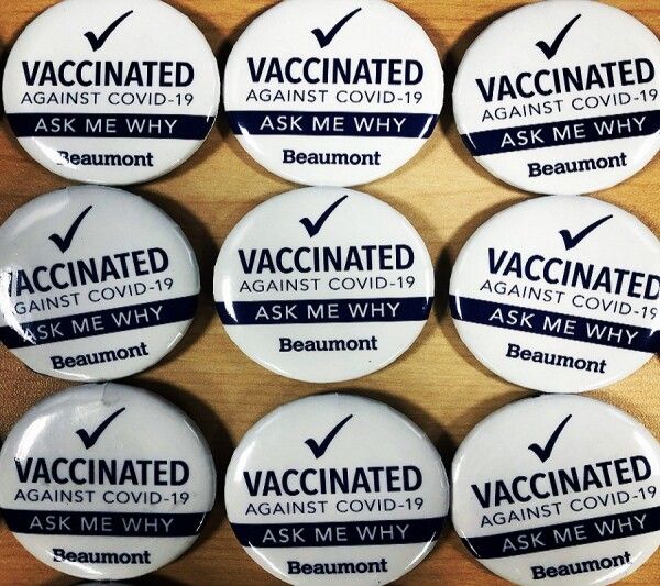 """Buttons showing text """"Vaccinated against COVID-19; Ask me why."""""""